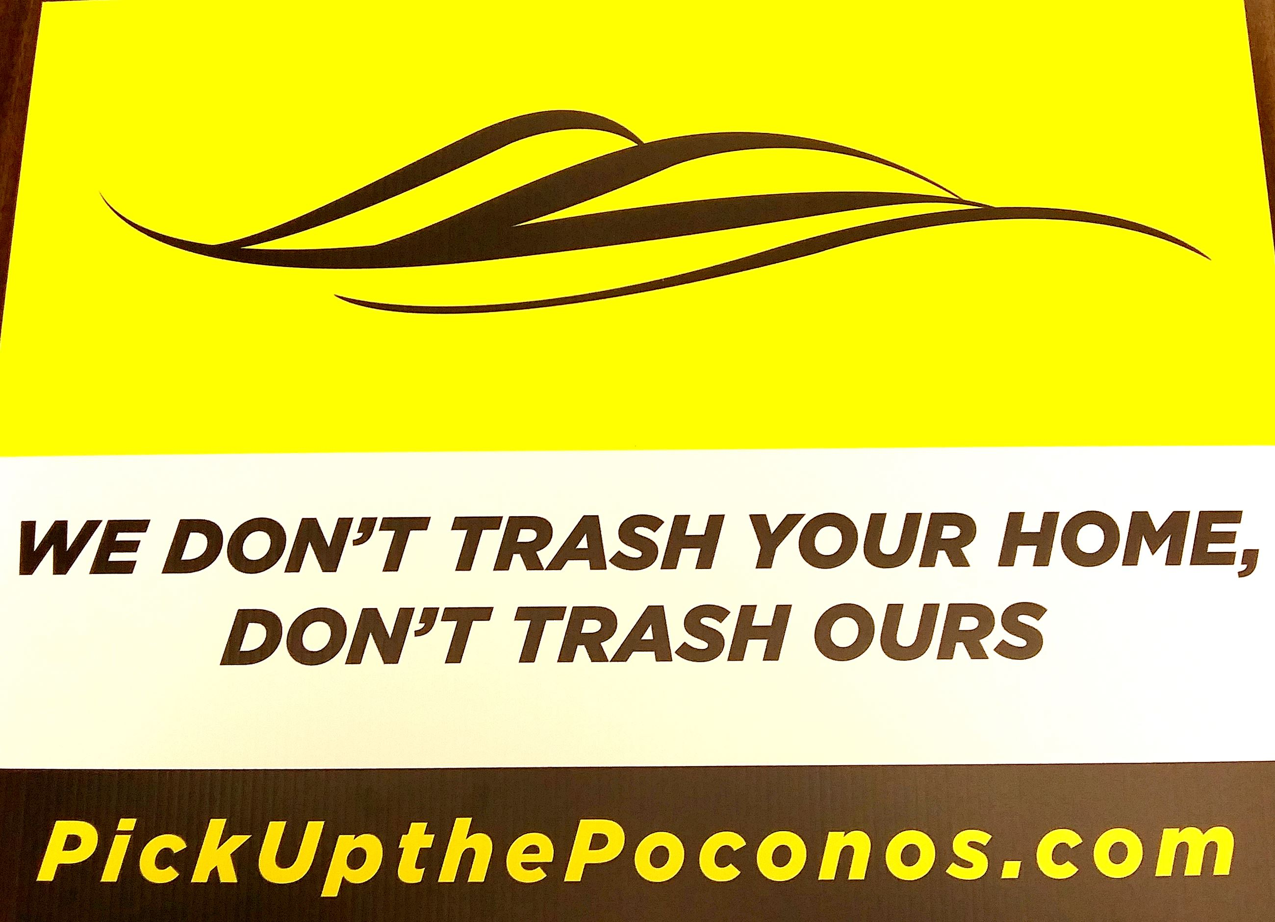 "A yard sign with the Pocono Mountains Vacation Bureau swoop logo advising people ""We don't tra"