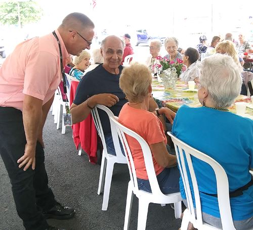 Commissioner Brian Smith talks with some folks at the Honesdale Senior Center's Summer Picnic.