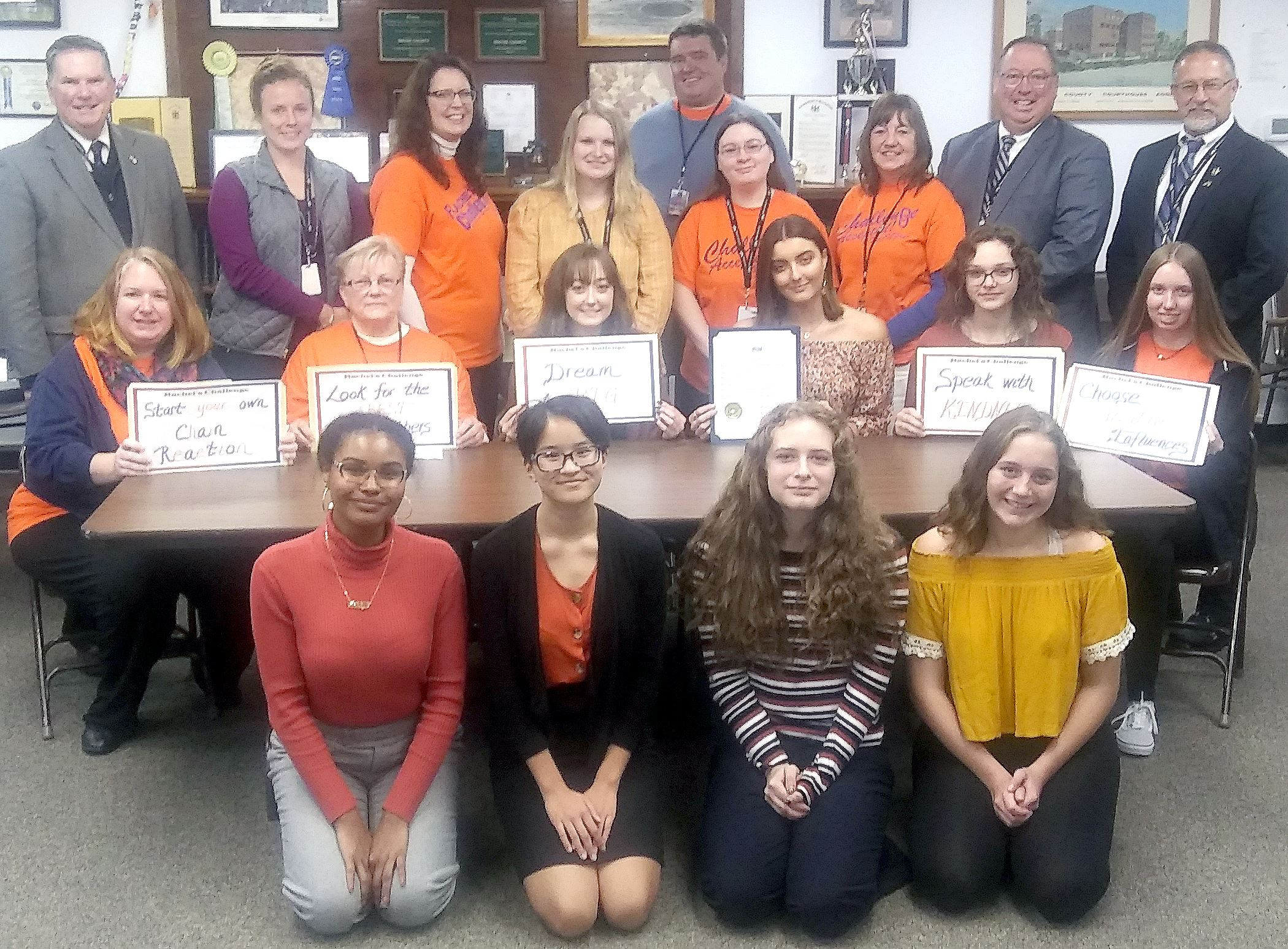 A group of high school students and representatives of the Wayne County Office of Behavioral & Devel