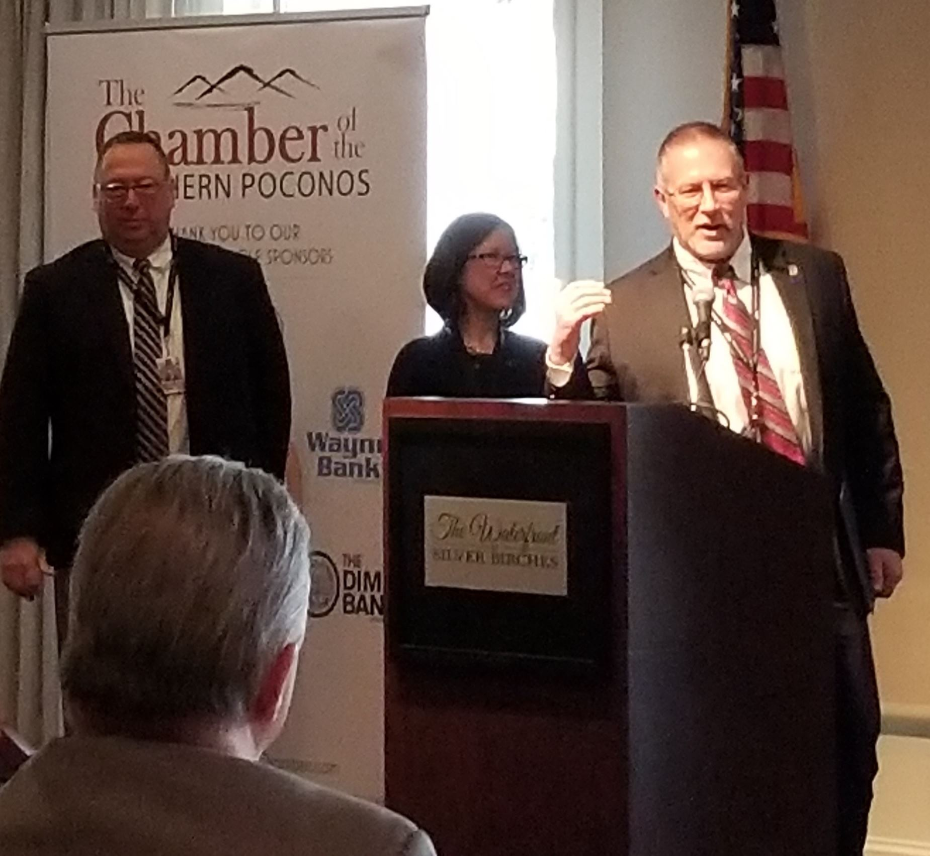 Wayne County Commissioners Joseph Adams, Jocelyn Cramer and Brian Smith speaking to the Chamber of t