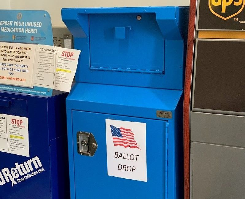 A blue, mailbox-style drop box for mail-in and absentee ballots just inside the Courthouse.