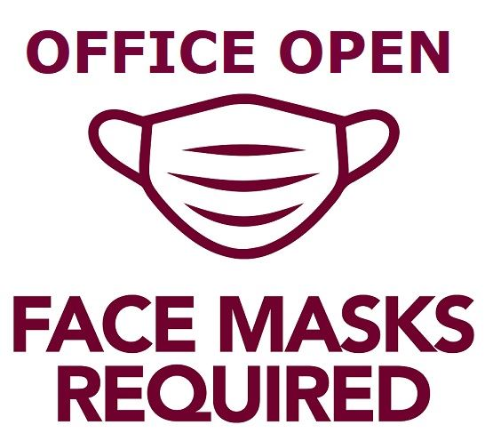 A sign with the shape of a face mask indicating the office is open and face covering are required.